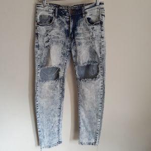 Light wash mid rise distress boyfriend jeans